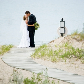 Bride and groom at Lake Huron by Traverse City Wedding Photographer Thomas Kachadurian