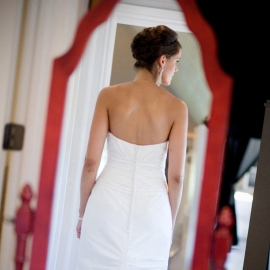 Bride in red mirror by Traverse City Wedding Photographer Thomas Kachadurian