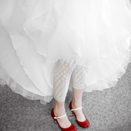 Bride with shinny red shoes by Traverse City Wedding Photographer Thomas Kachadurian
