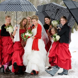 Bride and bridesmaids with umbrellas and rubber boots by Traverse City Wedding Photographer Thomas Kachadurian