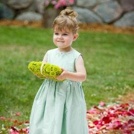 Cute flower girl by Traverse City Wedding Photographer Thomas Kachadurian