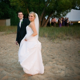 Bride and Groom on West Bay Beach by Traverse City Wedding Photographer Thomas Kachadurian