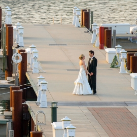 Wedding couple on the dock at Bay Harbor by Traverse City Wedding Photographer Thomas Kachadurian