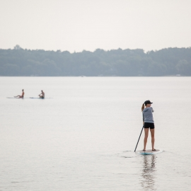 SUP on West Bay by Traverse City Photographer Thomas Kachadurian