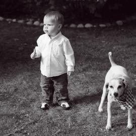 A boy and his Dogby Traverse City Portrait Photographer Thomas Kachadurian