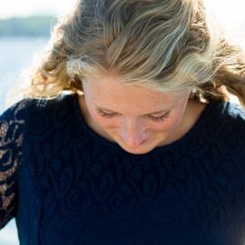 Blonde Woman looking down by Traverse City Portrait Photographer Thomas Kachadurian