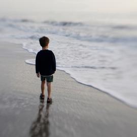 Boy at the shore by Traverse City Portrait Photographer Thomas Kachadurian