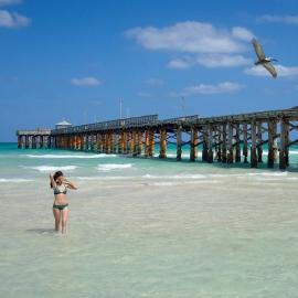 Woman at Sunny Isle Beach Pier by Traverse City Portrait Photographer Thomas Kachadurian