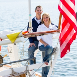Couple on a sailboat in Suttons Bay by Traverse City Portrait Photographer Thomas Kachadurian