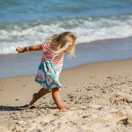 Young Child in the surf by Traverse City Portrait Photographer Thomas Kachadurian