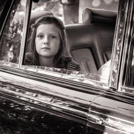 Girl in a Rolls Royce by photographer Thomas Kachadurian