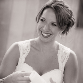 Bride trying not to cry by Traverse City Wedding Photographer Thomas Kachadurian