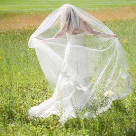 Bride in a meadow by Traverse City Wedding Photographer Thomas Kachadurian