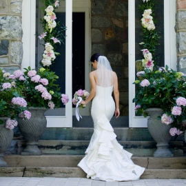 Glamorous bride in doorway by Traverse City Wedding Photographer Thomas Kachadurian