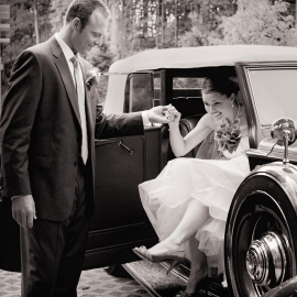 Bride with a classic car at The Homestead by Traverse City Wedding Photographer Thomas Kachadurian