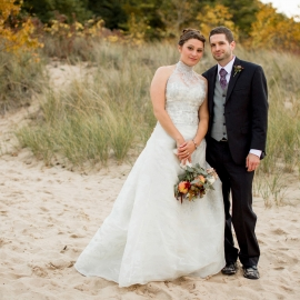 Bride and Groom on the beach at The Homestead in Glen Arbor by Traverse City Wedding Photographer Thomas Kachadurian