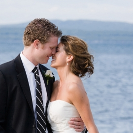 Wedding couple kiss in Petoskey by Traverse City Wedding Photographer Thomas Kachadurian