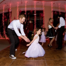 Groom and Flower Girl at Hagerty Center by Traverse City Wedding Photographer Thomas Kachadurian