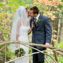 Bride and Groom on a rustic bridge by Traverse City Wedding Photographer Thomas Kachadurian
