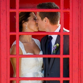 Wedding Couple in red phone booth by Traverse City Wedding Photographer Thomas Kachadurian