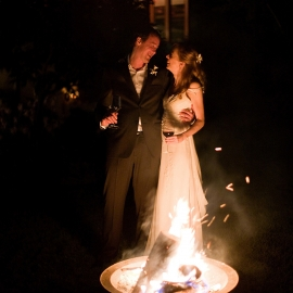 Bride and Groom by a wedding bonfire by Traverse City Wedding Photographer Thomas Kachadurian